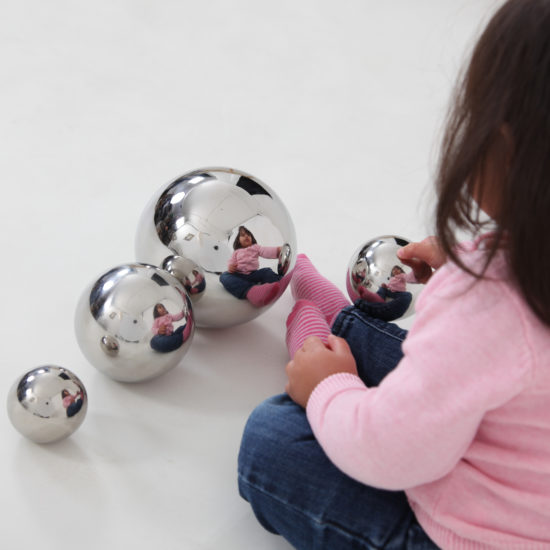 Four silver reflective balls for sensory play