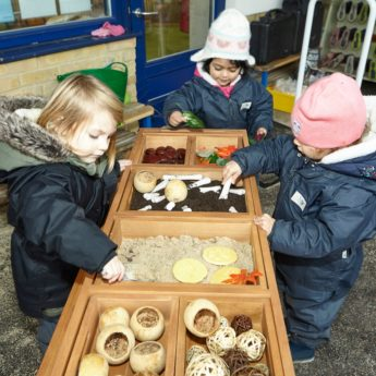 Hardwearing wooden outdoor table ideal for investigative play activities