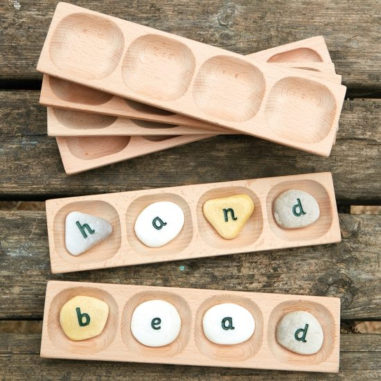 Blend and segment CVCC and CVVC words with this tactile wooden tray