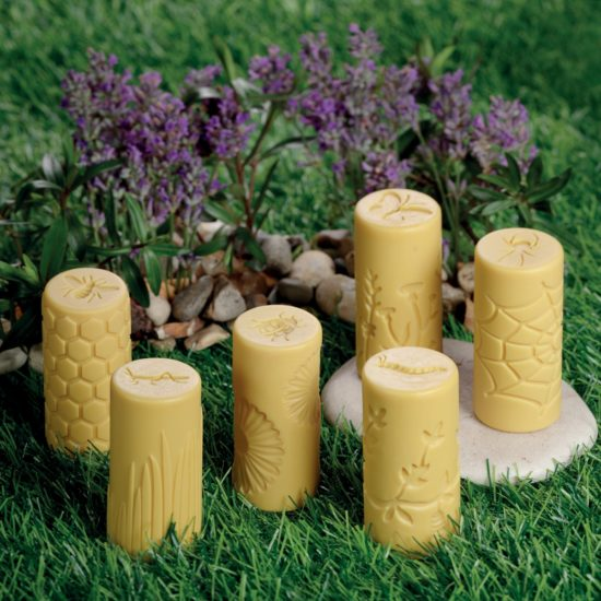 Set of 6 stone and resin rollers with garden designs