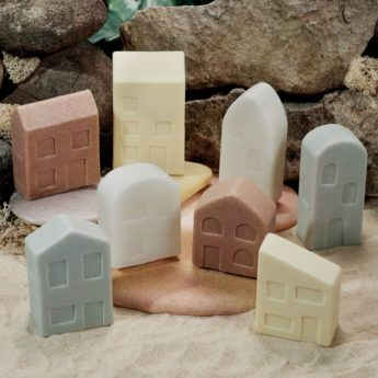 Set of 8 different houses made of stone and resin
