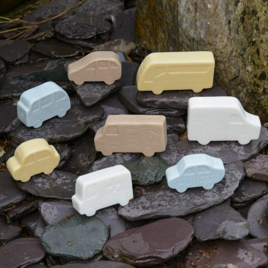 Set of 8 different vehicles made of stone and resin