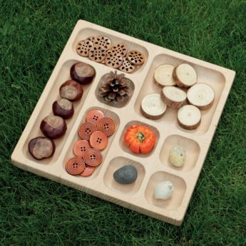 Wooden tray with different-sized sections for collecting items